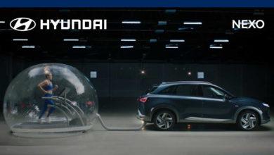 Photo of Elle fait du sport dans une bulle reliée à l'échappement d'un SUV à hydrogène